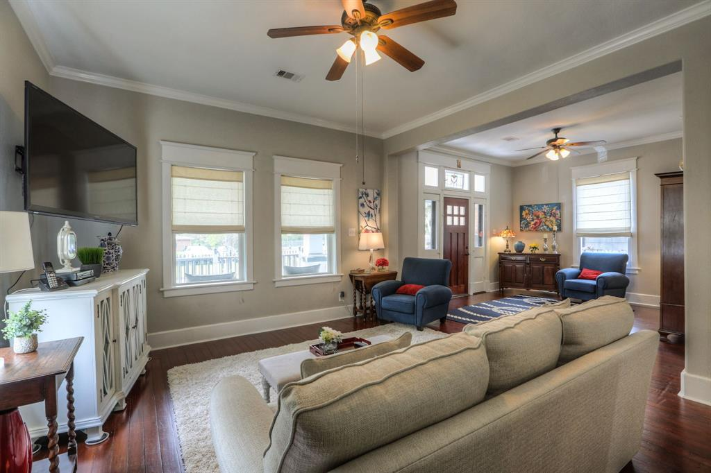 This large living room space provides a great space to wind down in the evenings and entertain friends. Original hardwood floors run through the living area.