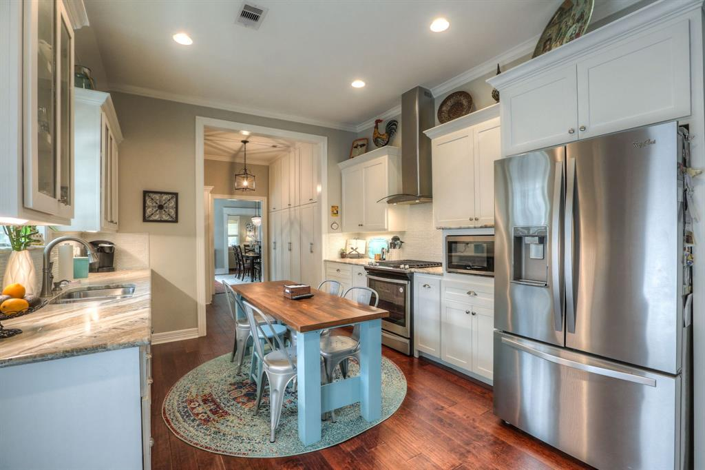 The kitchen was was remodeled starting in 2016. New stainless steel appliances, wood floors, and tons of cabinet space. On your tour, we will encourage you to open these cabinets to check out all of the custom touches, like drawers for pots and pans and a custom spice rack.