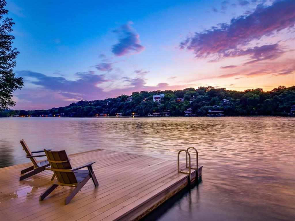 Spectacular Lake Austin contemporary steps from the shore. 180'+/-  waterfront. Complete 2014 renovation with a modern yet welcoming sophisticated design. Walls of windows w/ panoramic lake views from nearly every room. Built for entertaining w/top grade amenities. Chef's kitchen opens to dining, living & wine room. Resort-style master. Heavy duty boat lift/jet ski lift, sun deck, & covered patios for outdoor fun! Ideal as low maintenance lock & leave or primary home in Eanes ISD. Minutes to Downtown, The incredible shopping and restaurants of the Domain and Hill Country Galleria and easy access to Austin Bergstrom International Airport. Breathtaking sunsets convey!