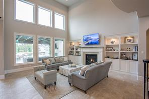 The family room has an eye catching Northeast-facing window wall designed to provide breathtaking waterfront views.