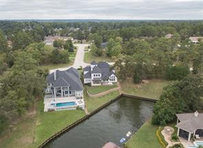 Located in a tranquil, secluded cove on an elevated site, this home is only seconds away from the main body of Lake Conroe. Its location provides safety from storms and high water. A boat slip and/or pool are permitted.