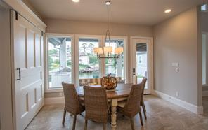 Here's a close up of the breakfast room. The door takes you right on out to the beautiful covered patio and the over-sized back yard. WOW look at the view! On the left is a barn door that leads to the game room.