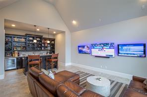 The game room is nothing short of fantastic.  The three televisions give you a heads up that the home owner is in to technology. This is a Control 4 Smart Home. It can be controlled from anywhere in the world.