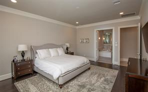 The room is quite large and will accommodate oversized furniture. The doorway leads to the unbelievable master bath. This area of the home is on an individual A/C.
