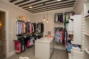 Here is another view of her closet. It's just so much fun as well as very well-thought out for storage of personal belongings.