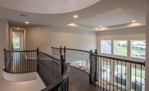 This dramatic view of the landing with its wrought iron rail is so impressive. Please notice the ceiling detail designed to catch your eye no matter which way you look.
