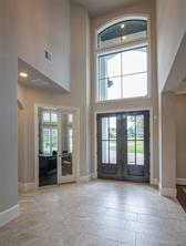 The home was built by Partners in Building with attention to detail from the engineered post tension slab to the exquisite finish work. Look at this stunning vaulted entry with double doors and double transoms. To the left is the entry to the study.