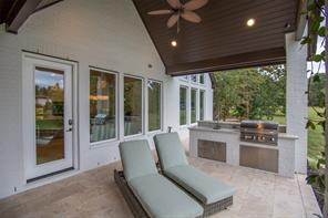The summer kitchen has a 32 inch Bull grill, sink and storage. The covered porch is deep enough to protect you in inclement weather.