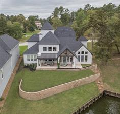 The yard is tiered allowing for a gradual approach to the lake front. The deed restrictions allow for a pool if you so choose. Certainly the elevation would be perfect for a gorgeous infinity pool. And, there would still be yard to spare.