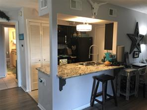Kitchen has stackable washer, dryer and fridge that will all stay!