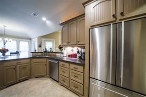 The kitchen is spacious and beautifully painted with tile floors and backsplashes