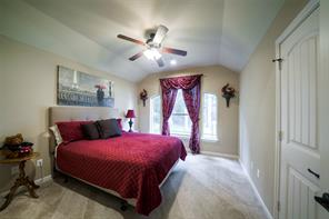 Secondary room with lovely architectural details and a ceiling fan.