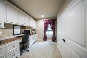The over-sized utility room offers a built in desk and cabinetry.