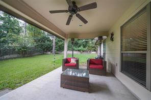 The covered pack patio features recessed lights and a ceiling fan.