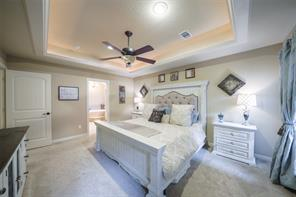 The master suite features beautiful ceiling details with recessed lighting and en-suite bath.