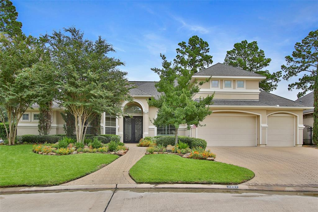 Custom home in GATED development! Fresh neutral paint throughout entire home! Located in cul-de-sac with paver driveway & walkway to arched entry through double iron doors! Travertine floors great you & flow though Dining, kitchen and family rooms. Plantation and Silhoette blinds t/o. Executive paneled study with built-ins and recessed desk area. Stunning wine grotto with iron gate, chiller & bricked arched ceiling.  Master bedroom w/wood floors & triple windows offering backyard views.Master bath offers walk in shower, jetted tub and his/her closets.Open concept kitchen and den with tremendous island with lower cabinet storage and serving areas. Paneled KitchenAid refrigerator, double drawer dishwasher, ice maker, 6-burner gas cooktop with pot filler. Multiple windows offer full backyard oasis views of Pebbletech chlorine pool with beach entry. Covered lanai w/ fireplace and outdoor kitchen. Pool bath. Upper game/media room. Brick back fence for ease in maintenance. Storage galore!