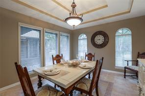 Another view of formal dining room. View facing entry way. Five large windows flood this room with natural light.