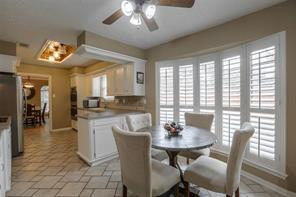 Large bay window with custom shutters adorn this breakfast area. Plenty of natural light!