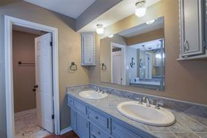 Tons of character and detail in this 2nd full bath just off bedroom #2 and #3. Note the unique accent stone flooring in the wet area! Entire space large, functional and super cute!