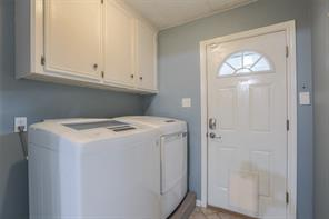 Large utility room just off the kitchen leading out to the back porch. Right of frame: Half bath and small utility closet containing new (2017) TANKLESS WATER HEATER.