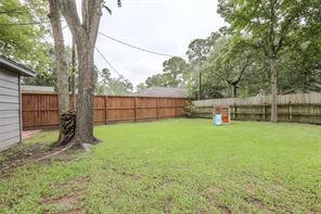 Enjoy the privacy offered by this, recently installed, [74 tall] cedar privacy fence! Mature trees shade this backyard oasis.