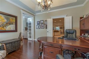 French doors open to study. Vaulted ceiling with decorative chandelier give the added touch to this room