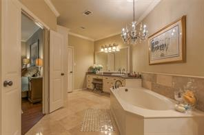 Granite countertops and travertine tile in this spacious master bath