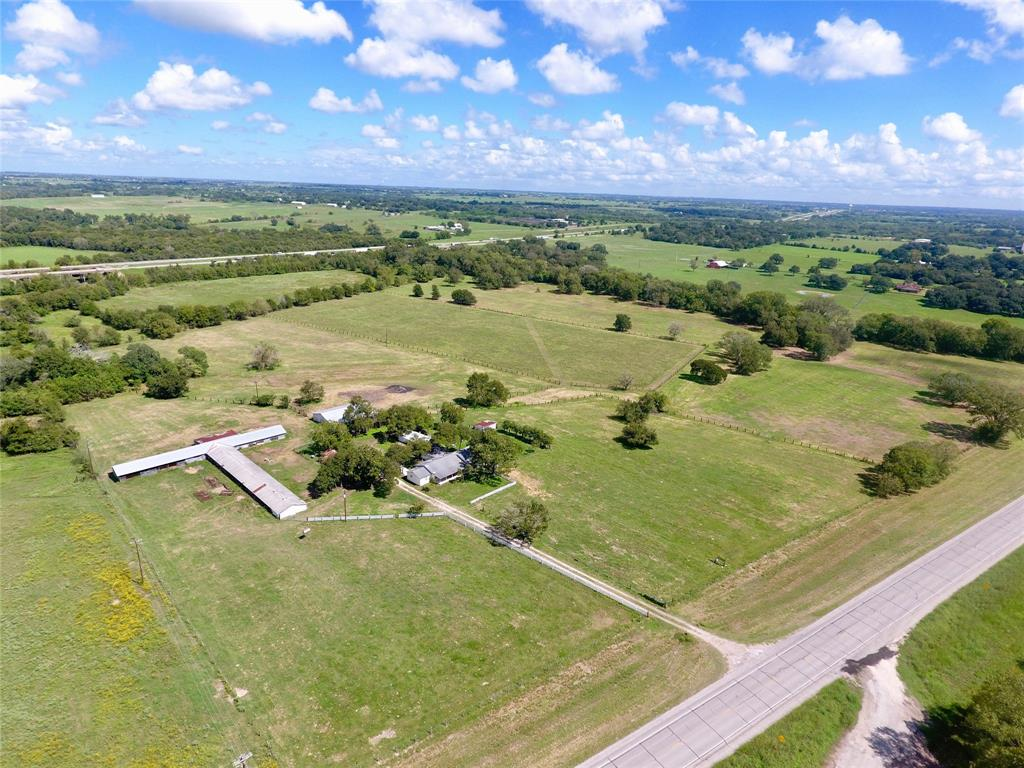 Once in a lifetime opportunity to own land a mile from the Schulenburg city limits. This 41 acre tract sits in a highly desirable area of Fayette County, and has 1,900 feet of West Navidad River frontage!  The large homestead house sits on top of a hill overlooking the river bottom and is ready for your opportunity to remodel and make it your own! Property is fenced and cross-fenced and is ready to run cattle, cut hay, or do a little hunting! Mature Oak and Pecan trees are dotted along the pasture and river frontage. Don't miss your chance to build your dream home either, as the homestead site has a wonderful view overlooking the river.*Disclaimer, according to FEMA maps, this property is in the FEMA floodplain.*