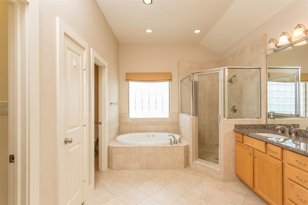 Master bath features dual vanities with granite counter top and separate tub and shower.