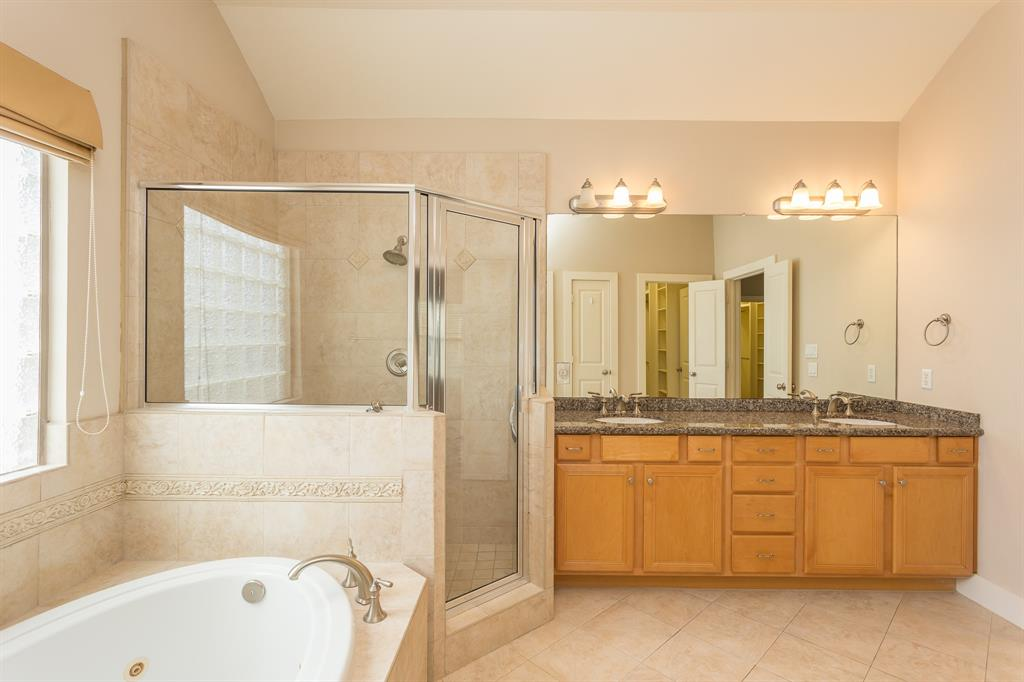 Check out the large shower and jetted tub.  A perfect space to start or end your day.