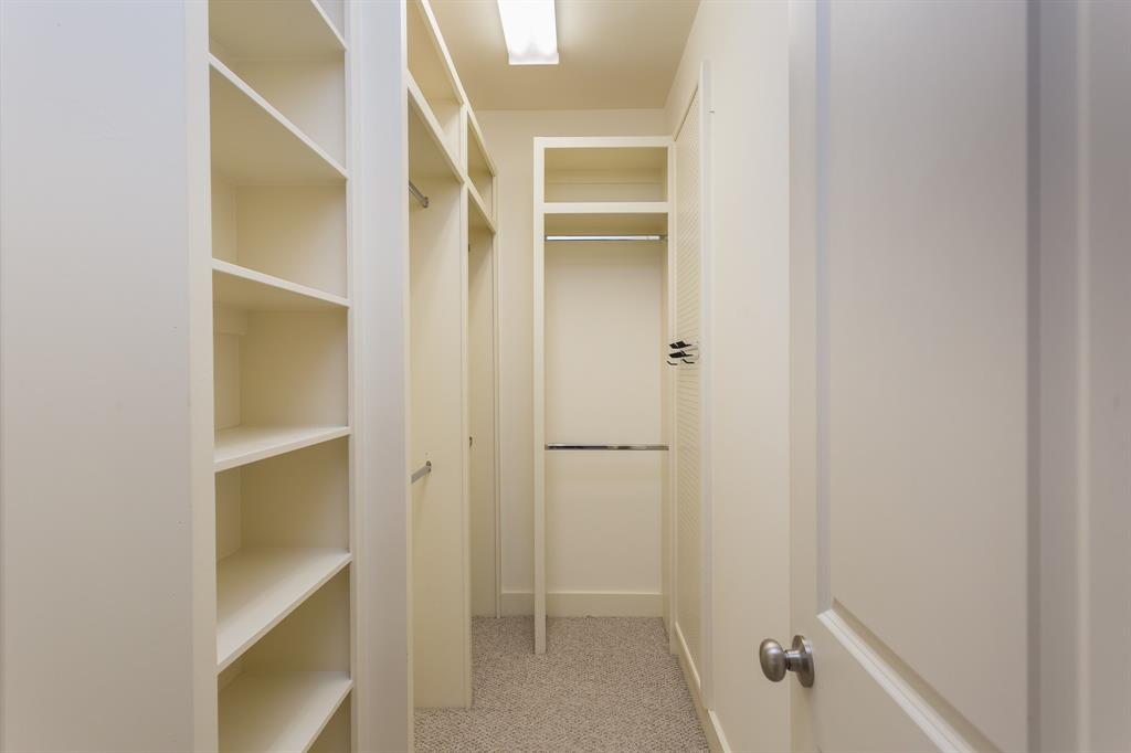 This is one of two walk-in closets in the master suite.