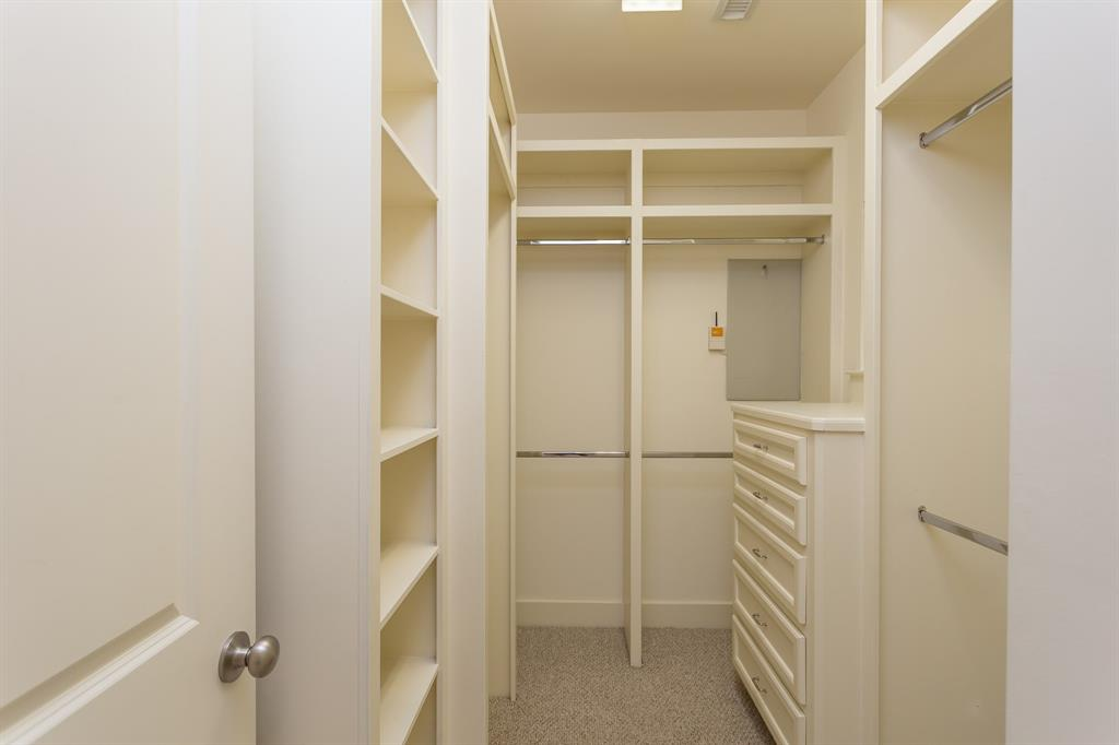 The second walk-in closet in the master suite with built-in storage.