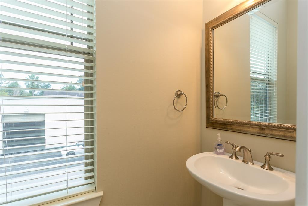 Half bath on the second floor offers easy access for guests in the living spaces.