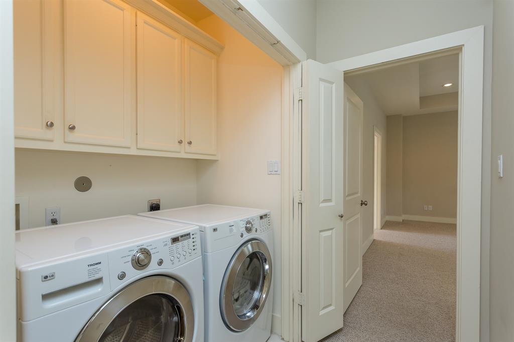 Laundry room adjacent to the master suite.