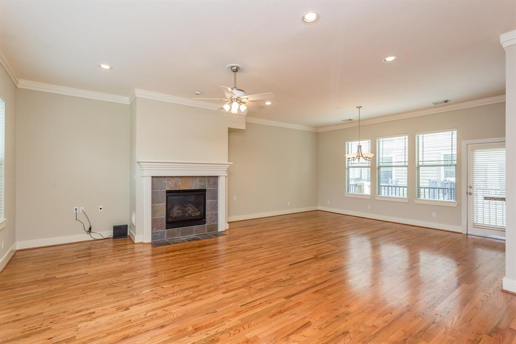 The living spaces feature wood floors, crown molding and a gas fire place.