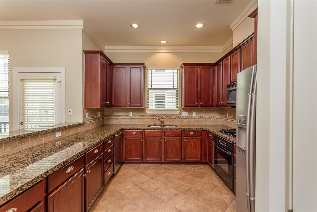 The family chef will love the spacious kitchen with granite counter tops, lots of storage and gas cook top.