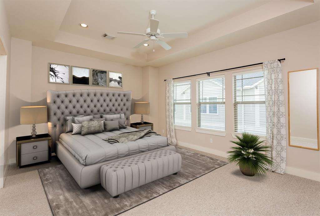 Large master suite with recessed ceiling and lots of natural light.