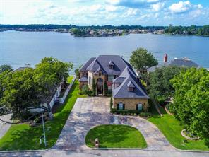 WATERFRONT LIVING at its finest in the gated community of April Sound don't miss viewing!