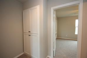 Linen closet is located at the top of the staircase.