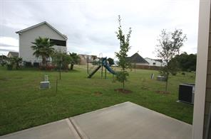 View off the back patio. Greenbelt is directly behind home and there is a small park for kids.
