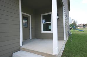 Closer look at the covered front entryway. Note no future townhome will be connected to this one on the right hand side as there is a side yard that belongs to this unit.
