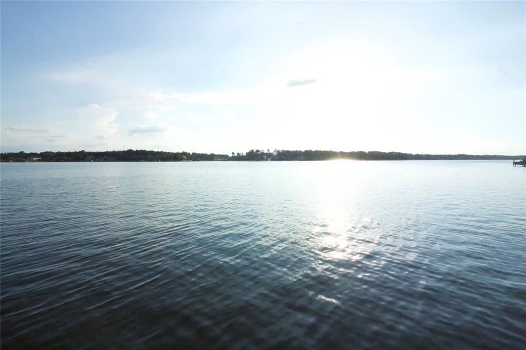 WOW! WIDE OPEN Lake Conroe WATERFRONT view in prestigious Bentwater! This QUIET and PEACEFUL location has over 12k sf, and is ready for your dream home with AMAZING VIEWS! Bentwater has it all! 54 holes of golf and this particular lot has the Country Club membership right now that gets access to 36 holes of golf. The Grand Pines Membership is also available for this lot if you desire to upgrade and have access to all 54 holes available! Bentwater also has the country club, sports club, yacht club, tennis club, parks, church, boat launch, and 24 hour manned security at both entrances. Coming home FEELS LIKE YOU'RE ON VACATION EVERY DAY! Come enjoy this unique lot in a unique location.