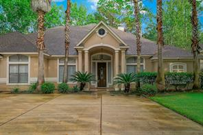 Home features a two car/golf cart garage and attractive landscaping.