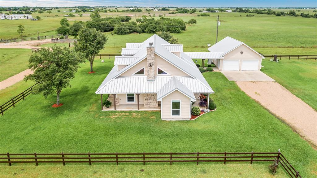 Country living at it's finest!  Nearly 14-acres of land to run your cattle or horses.  This property features a 2-story, 3 bedroom, 2 1/2 bath immaculately maintained home, a 41x21 metal building outfitted with steal beams and electricity, 500 gallon propane tank, and a $18,000 GENERATOR the runs the entire house and metal building!  A/C only 2 years old and water heater is 6 months old. With picturesque sunsets in the evening, imagine yourself unwinding from a busy day on the huge covered front and back porch. Very lightly restricted with NO RESTRICTIONS, MUD TAX, or HOA.  Ideal location with only 30 minutes to Katy yet, enjoy the privacy of feeling like you're in the middle of nowhere.  Washer, dryer, refrigerator, microwave, air compressor, tractor, and rake stay with the home!  You will not be disappointed with this pristine property! Make your appointment today.