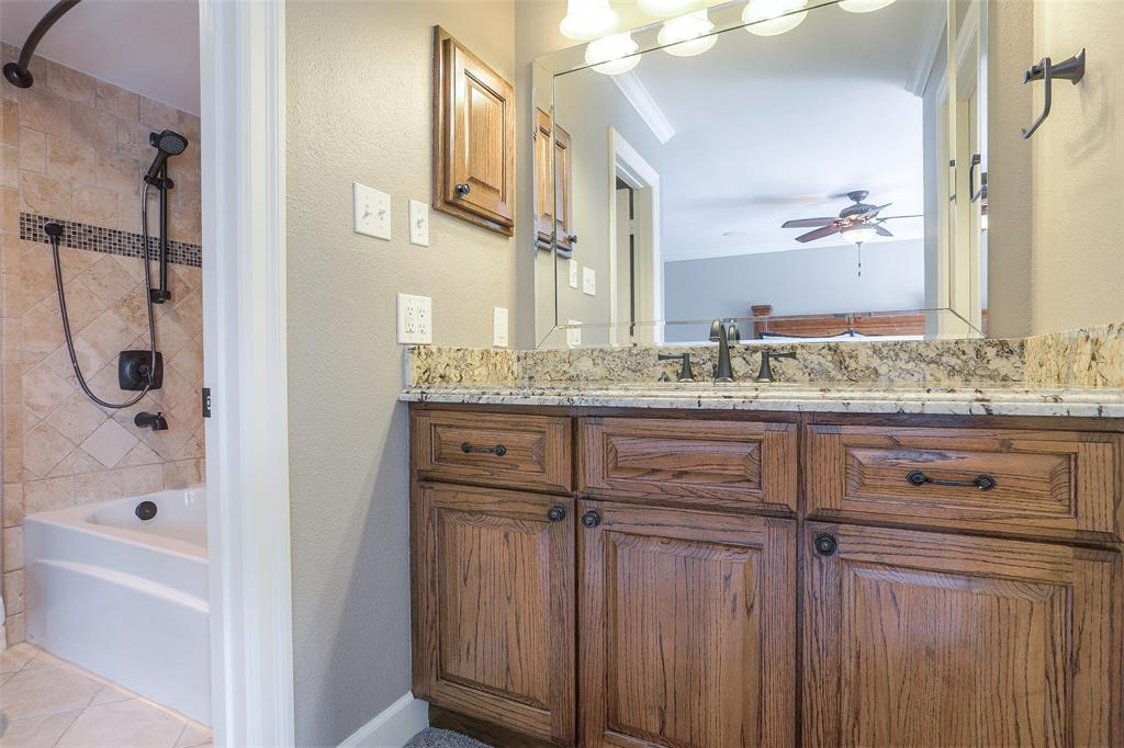 The master bathroom has been updated with granite counter-tops, a soaking tub, and updated tile surround & floors.