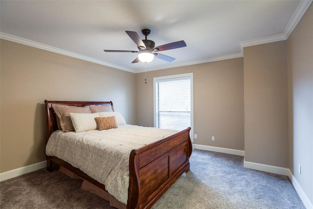 This guest bedroom is good size.  It includes updated carpets, crown molding, generous closet space, and an en suite.
