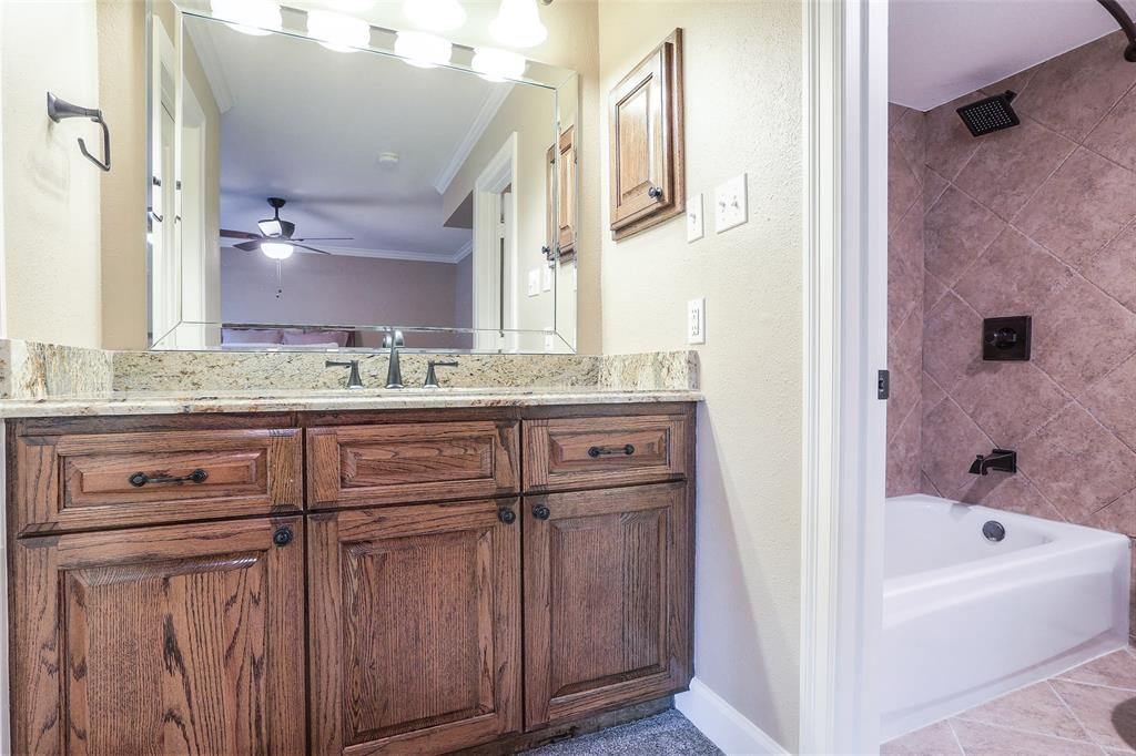 The guest bedroom en suite has also been updated with a new tub, granite counter-tops, and updated tile surround & floors.
