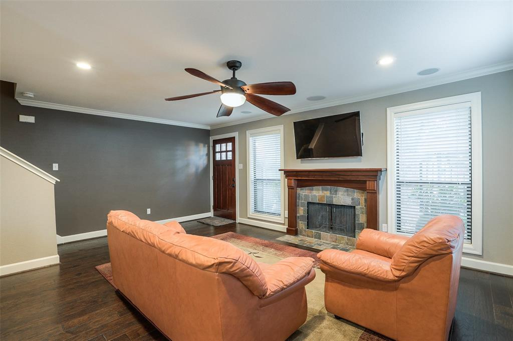 Per the seller, the home was updated in 2013.  This large living room space has been updated with engineered Wood Floors, recessed lighting, surround sound speakers, window treatments, wood-burning fireplace, and crown molding.
