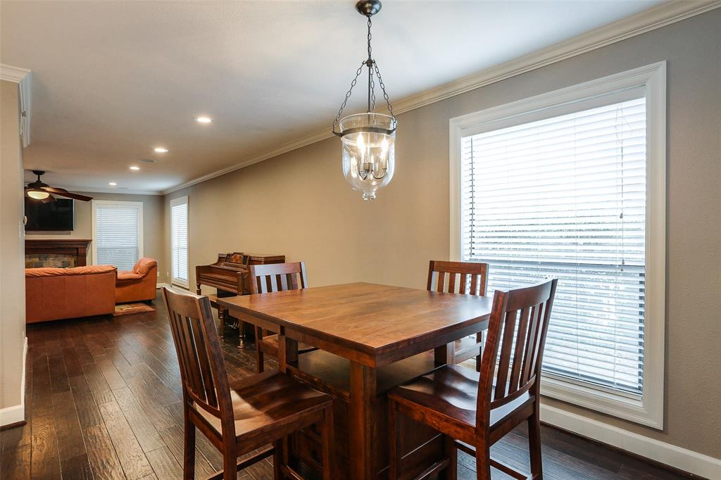 This space currently includes a sizable breakfast table.  However, it can also accommodate a much larger dining room table as well.