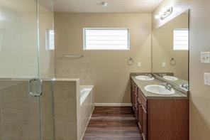 The Master Bath has 2 Sinks and a separate Shower and Tub.